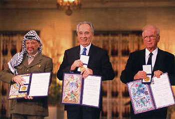 Chairman Y. Arafat and PM Itzhak Rabin after signing the Oslo Agreement, 1993